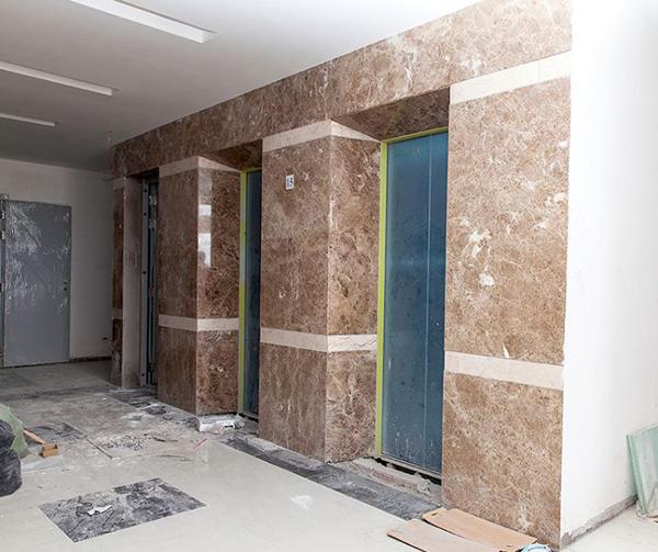 Kết quả hình ảnh cho mặt tiền thang máy đá marble nâu tây ban nha
